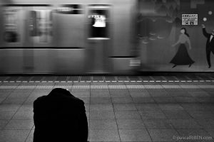 A Japanese man is sleeping while waiting the subway