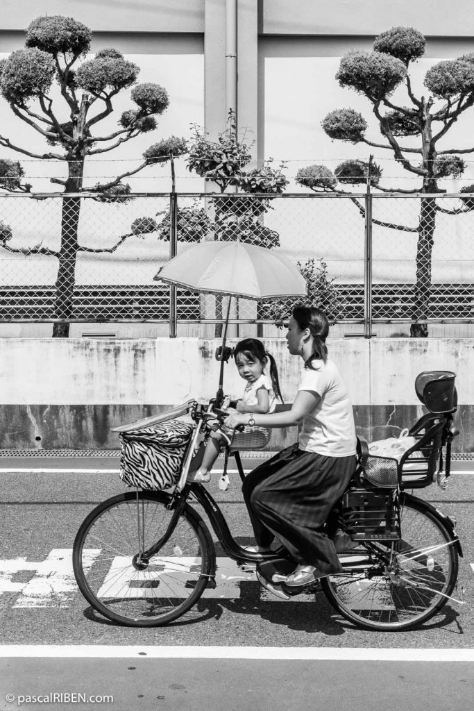 Mother and daughter on Bicycle, in Daitō, Osaka prefecture, Japan