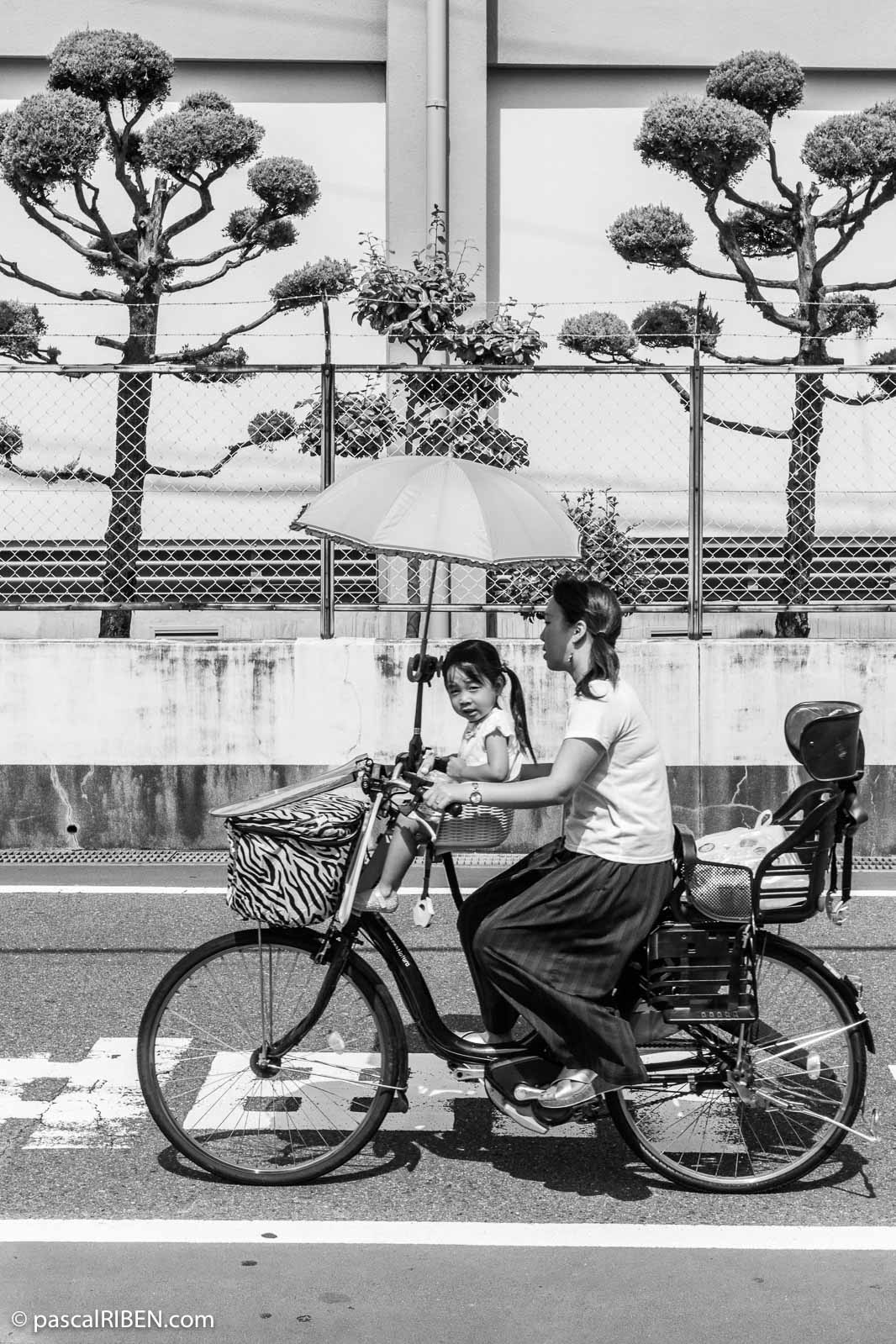 Mother and daughter on Bicycle, Daito, Japan, 2018