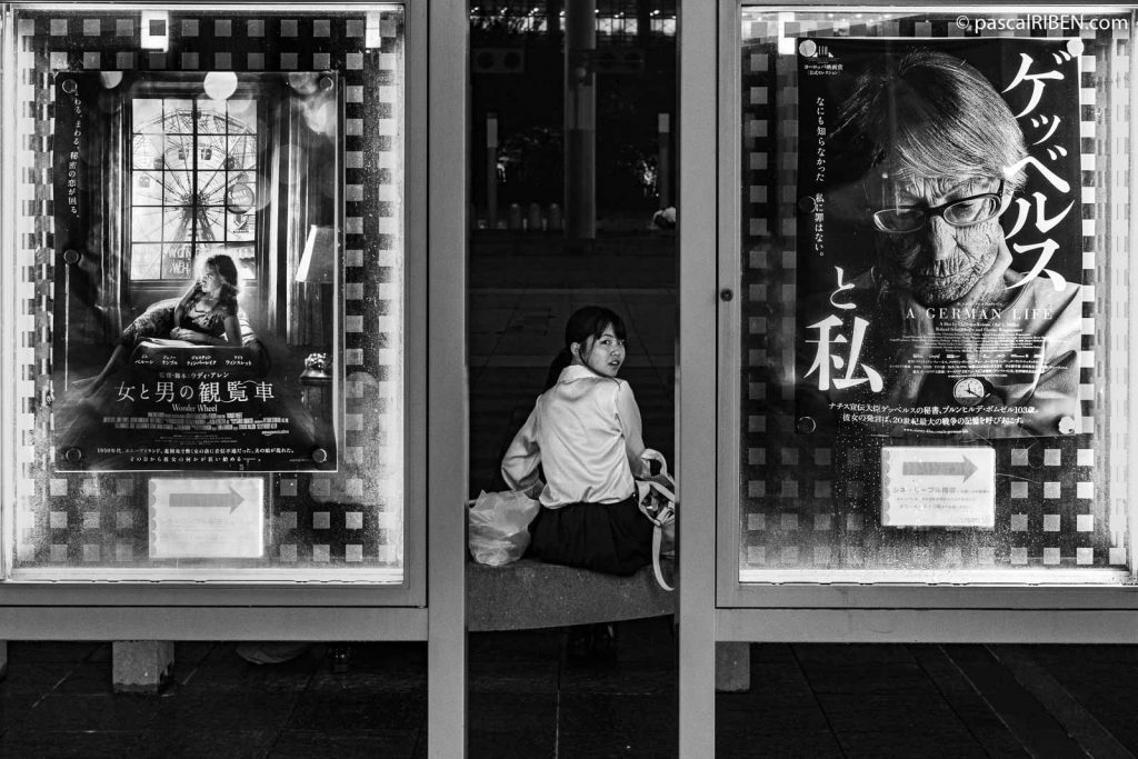 "Two posters and a young Japanese woman from the cinema inside the Umeda Sky Builing: ""A German Life"" and on the left, Woody Allen's ""Wonder Wheel"" movie."