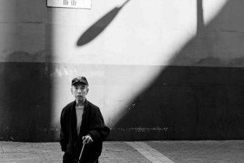 Elderly Man and Shadow on Temple Street - Hong Kong, China