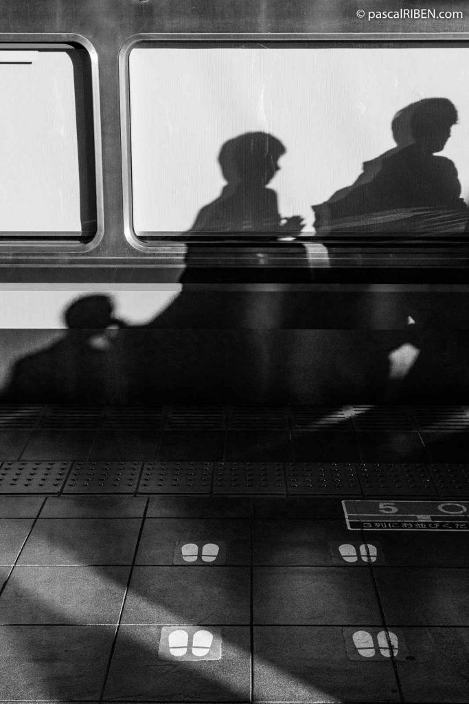 Shadows on the car and marking at Osaka Station.